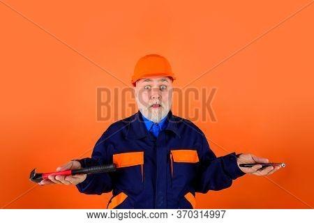 Builder With Repair Tools. Building. Industry. Old Man In Construction Helmet. Engineers Working. Re