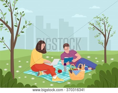 Young Man And Woman Are Resting In Nature. Rest And Work At A Picnic. Reading A Book At A Picnic.car