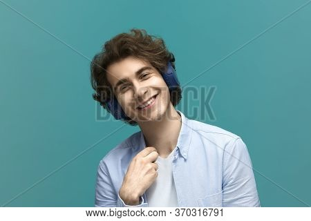 Im Very Glad.portrait Of A Young Beautiful Man Wearing White T-shirt And Blue Shirt With Headphones