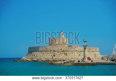 Rhodes, Greece - July 2019: Mandraki Harbor In Sunny Day