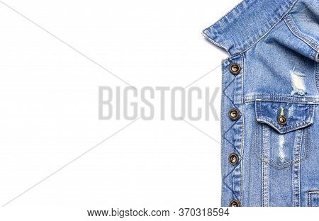 Close-up Blue Denim Jacket On Isolated White Background Top View Flat Lay Copy Space. Denim, Fashion