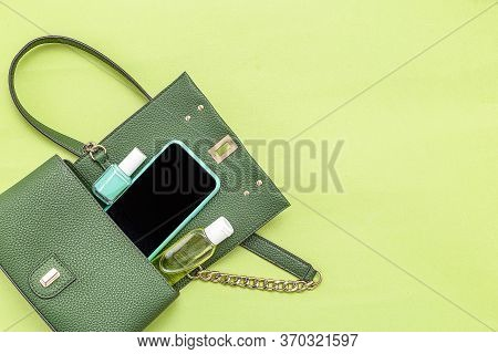Handbag, Phone, Nail Polish  And Disinfection; Gel On Green Background. Monochrome. Minimal. Copy Sp