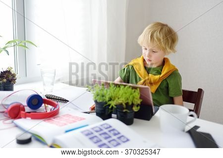 Elementary Student Boy Doing His Homework With Tablet At Home. Homeschooling, Remote Studying, Video