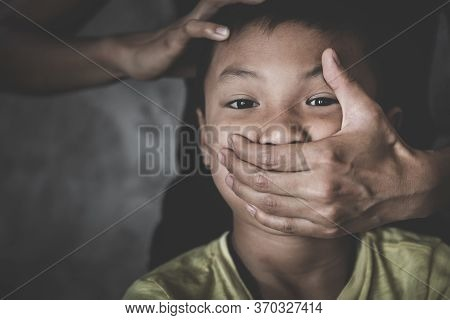 Scared  Child With An Adult Man's Hand Covering Her Face. Stop Abusing Violence,  Human Trafficking,
