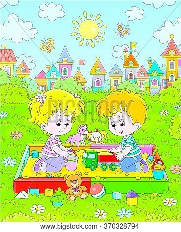 Happy Children Friendly Smiling, Romping And Playing With Their Funny Colorful Toys In A Sandbox On
