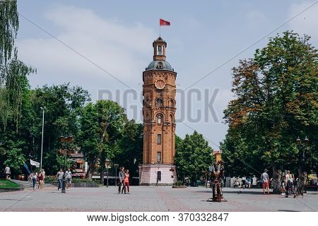 Vinnytsia, Ukraine. Red Brick Town Hall In The City Center. Town Hall With A Clock In The City Squar