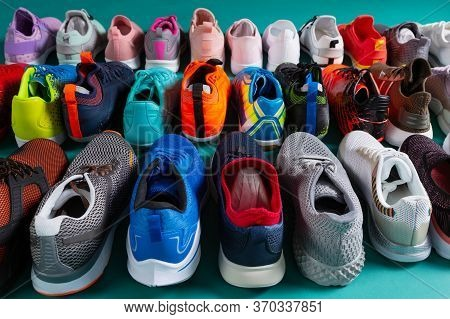 Many Colored Sports Shoes, Sneakers And Soccer Shoes, Stand In Three Rows, The Back Side, The Concep