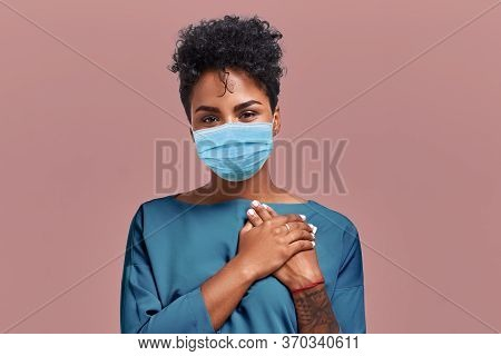 Portrait Of Kind Hearted African American Female Paramedic Wearing A Respiratory Mask From Coronavir