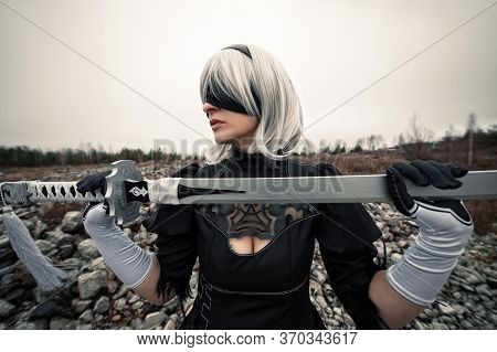 Woman In White Wig And Sword With Blindfold