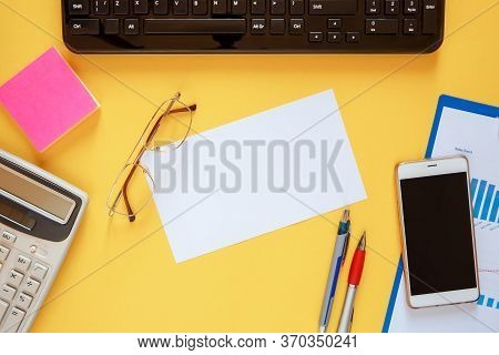 Workspace Office Desk - Flat Lay Photo On Top Of Workspace With Blank Note Mockup On Yellow Backgrou