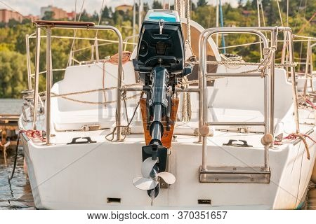 Back Shot Of Boat With Outboard Engine. Ship Propeller.