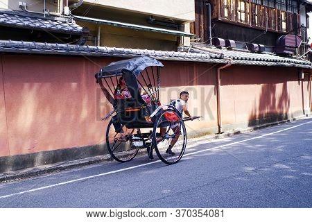 Japan, Kyoto. 2018. Rickshaws Are Popular In Kyoto.japan, Kyoto. 2018. Japanese Rickshaw Rides A Gir