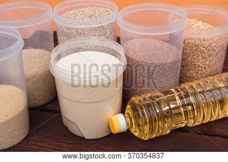 A Bottle Of Sunflower Oil And Various Cereals In The Kitchen