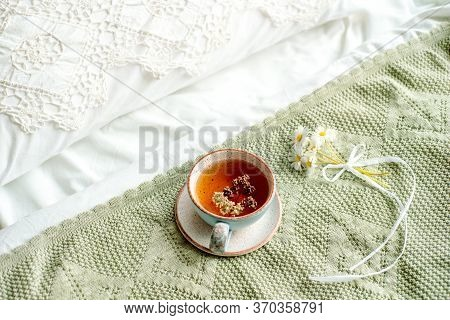 Laptop, A Cup Of Tea, White Bed And Plaid. Sunny Morning And Breakfast. Work Online In A Comfortable