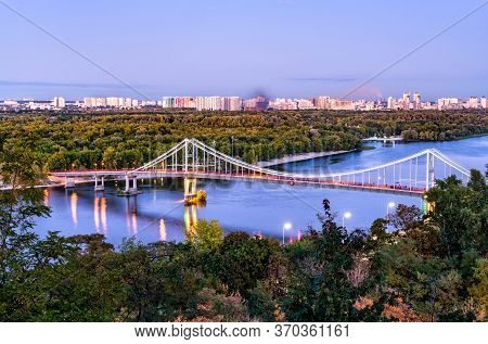 Pedestrian Bridge Across The Dnieper River In Kiev, The Capital Of Ukraine