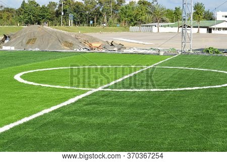 Between The Dividing Line Of The Football Field, Artificial Grass And The Surrounding Area Is Under