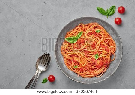 Tomato Spaghetti In Gray Bowl On Concrete Background. Tomato Sauce Pasta Is Classic Italian Cuisine