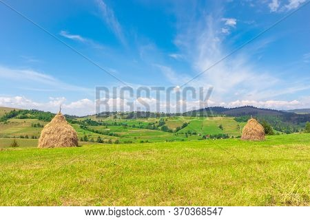 Weathered Hay Stack On The Field. Idyllic Coutryside Scenery On A Sunny Day. Wonderful  Rural Landsc
