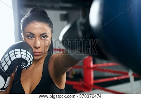 Front View Of Attractive Muscular Brunette Woman With Strong Face Wearing Boxing Gloves And Black To