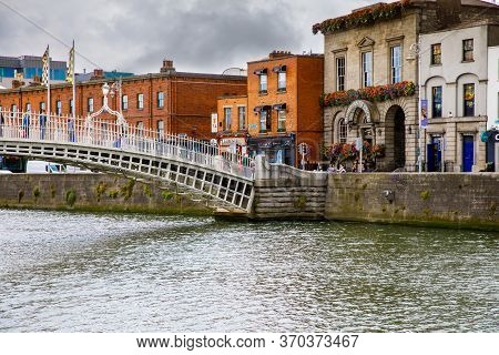 Dublin, Ireland - July 1, 2019: Hapenny Bridge In Dublin, Famous Tourist Attraction. Half Penny Over