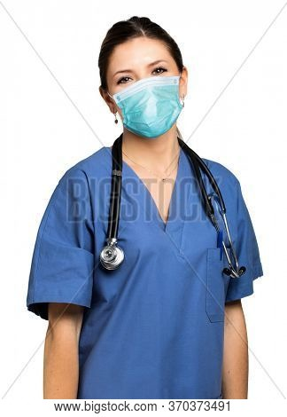 Healtcare worker with stethoscope isolated on white wearing a mask, coronavirus concept