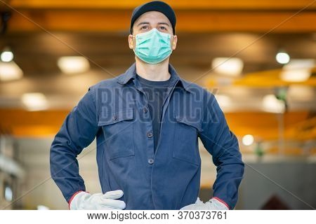 Worker in a factory wearing a mask during coronavirus covid-19 pandemic