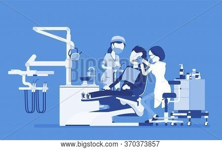 Female Dentist At Work In Clinic. Dentistry Office With Professional Equipment, Male Patient In Rece