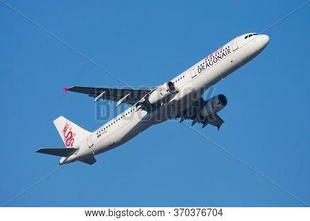 Hong Kong / China - December 1, 2013: Dragonair Airbus A321 B-htd Passenger Plane Departure And Take