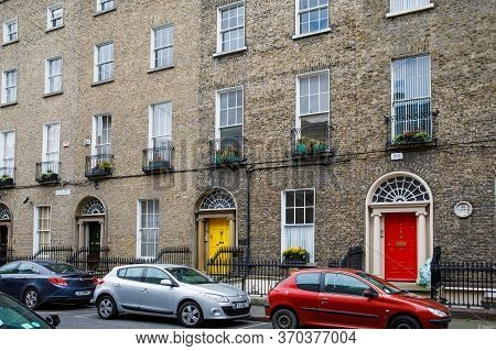 Dublin, Ireland - July 2, 2019: Quarter With Colorful Georgian Doors In Dublin, Ireland. Historic Do