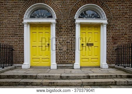 Colorful Georgian Doors In Dublin, Ireland. Historic Doors In Different Colors Painted As Protest Ag