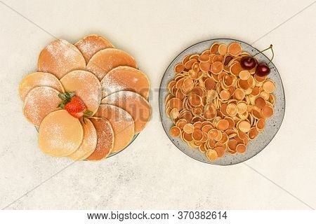 Traditional Pancakes And Cereal Pancakes In Grey Plates On Light Background. Top View Pancakes With