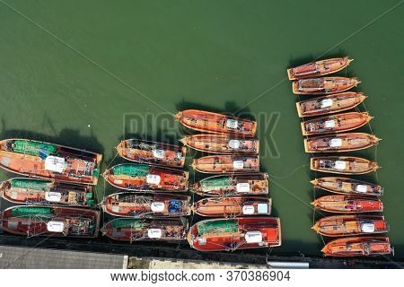 Fleet of fishing boats in port in Thailand.