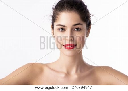 Beauty Shot Of Young Woman Wearing Red Lipstick While Standing At Isolated White Background