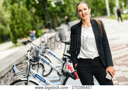 Use Environmentally Friendly Modes Of Transport. Cheerful Young Businesswoman In Smart Casual Wear L