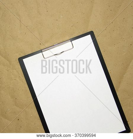 A Tablet With A White Sheet Of A4 Format On A Beige Craft Paper. Concept Of New Opportunities, Ideas