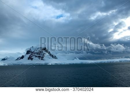 An Inhospitable Landscape On Antarctica On A Cloudy Day.