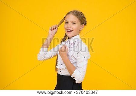 Welcome Back To School. Small Schoolgirl With Happy Smile. Little Schoolgirl Looking Nice In School
