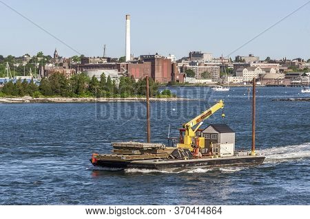 Fairhaven, Massachusetts, Usa - June 8, 2020: Small Tug And Barge Hauling Equipment Out Of Fairhaven