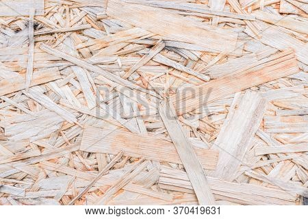 Wood Chipboard Background. Top View Of Osb Wood Veneer Background