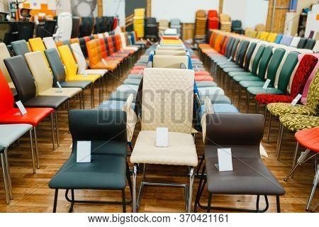 Rows of chairs in furniture store showroom