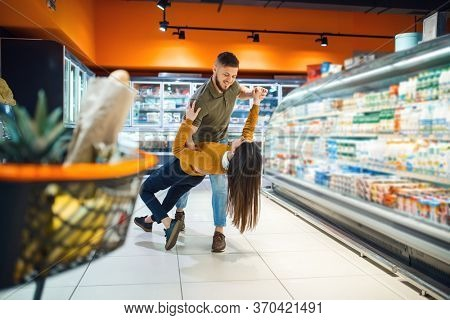 Love family couple dancing in grocery store