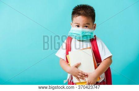 Back To School Coronavirus Covid-19 Education. Portrait Asian Little Child Boy Kindergarten Wear Fac