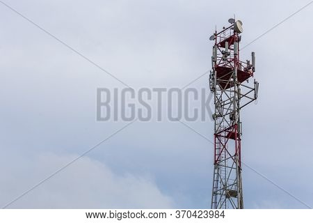 3g, 4g, 5g, Wireless And Cell Phone Telecommunication Tower Close-up On Cloudy Daylight Sky Backgrou