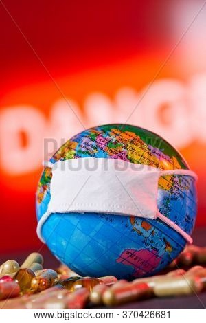 Surgical Face Mask and Globe model. Coronavirus Concept.