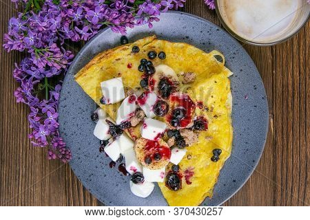 Tasty Pancakes With Bananas, Blueberries And Honey On Blue Plate. Closeup View. Homemade Pancakes. P