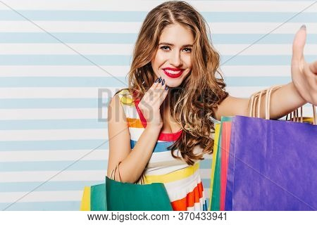 Gorgeous Caucasian Woman Having Fun After Shopping. Indoor Portrait Of Good-humoured Female Shopahol