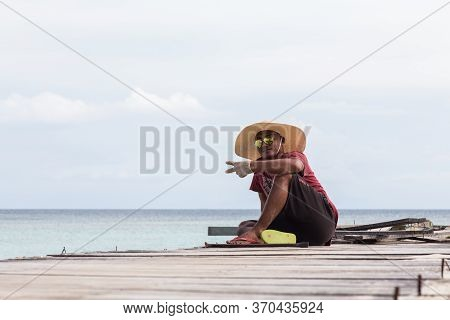 Mantanani Island, Sabah, Malaysia-circa September, 2017: Unidentified Local Worker On Resting After