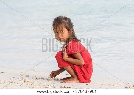 Candid Image Of Unidentified Local Mantanani Island Kids Playing Sand
