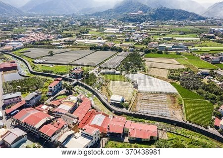 Nantou, Taiwan - October 30th, 2019: aerial view of Puli town with buildings and farms, Nantou, Taiwan