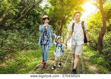 Happy Family Hiking Through The Forest Background